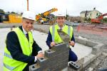 Minister views progress of 20 new apartments and six family homes
