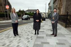 Communities Minister Deirdre Hargey has visited Enniskillen to view progress of major public realm works throughout the town which are midway through completion.