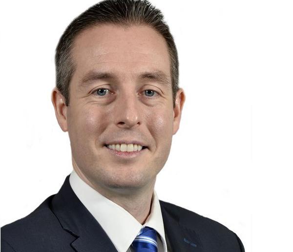 Minister Paul Givan