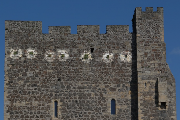 Carrickfergus Castle, Image showing seven holes in Keep walls