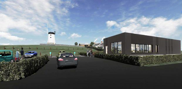 Computer generated image of the project show the new visitor centre/café, the car park and the landscaping works at the windmill