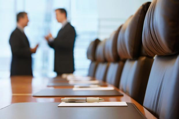 Image showing two men in a boardroom