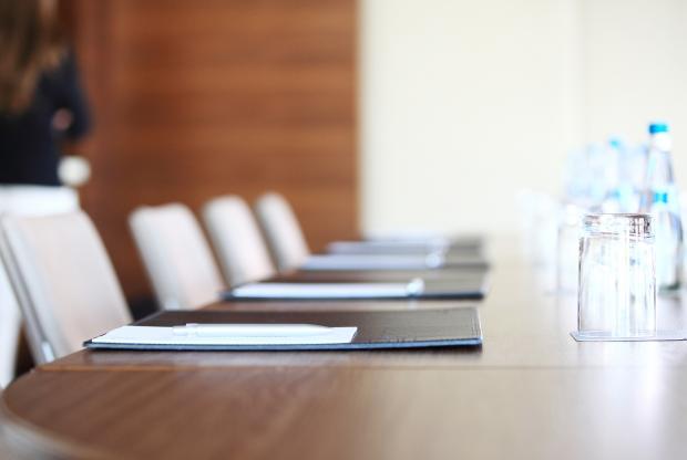 Image of a desk in a boardroom