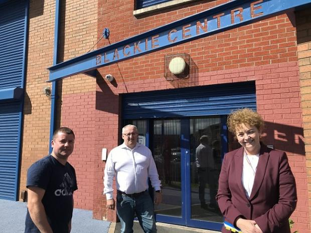 Communities Minister Carál Ní Chuilín pictured at the Blackie Centre with Sean Quinn, chairman of Blackie River Community Group and Community Development Coordinator Ciaran Beattie for the reopening of the COVID-19 Charities Fund