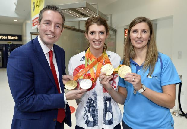 Sports Minister Paul Givan, MLA has welcomed swimmer Bethany Firth back to Northern Ireland after her historic performance in Rio. Also pictured is Elaine Reid from, Disability Sport NI.