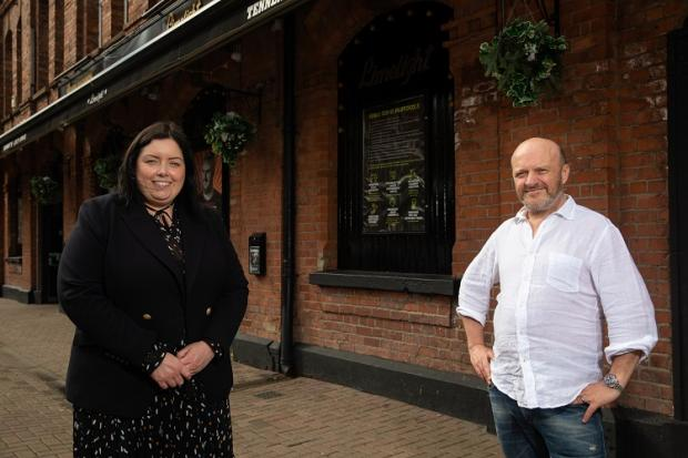 Communities Minister Deirdre Hargey is pictured with Alan Simms during a visit to The Limelight in Belfast, a live music venue.