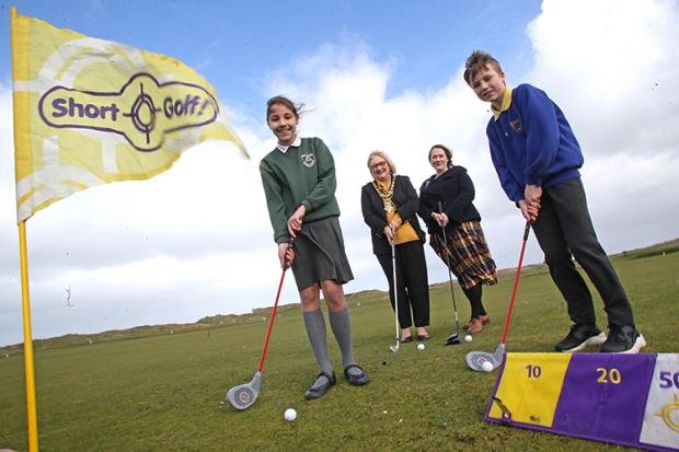 School children playing golf at the launch of the Legacy Primary Schools Golf Programme