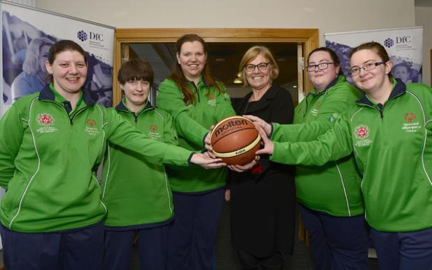 DfC Permanent Secretary Tracy Meharg with a number of athletes from Special Olympics Ulster