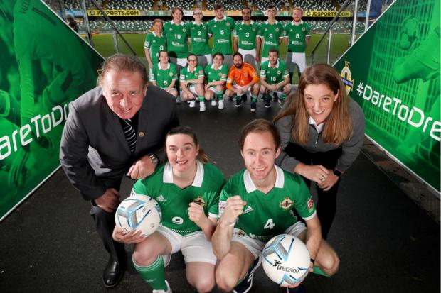 Gerry Armstrong and Kathryn Hill with the Northern Ireland Homeless World Cup squad
