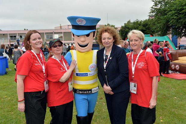 Sports Minister, Carál Ní Chuilín with WPFG Mascot Emergency Eddie and Games volunteers at the opening ceremony for the Belfast Games held at the Kings Hall.